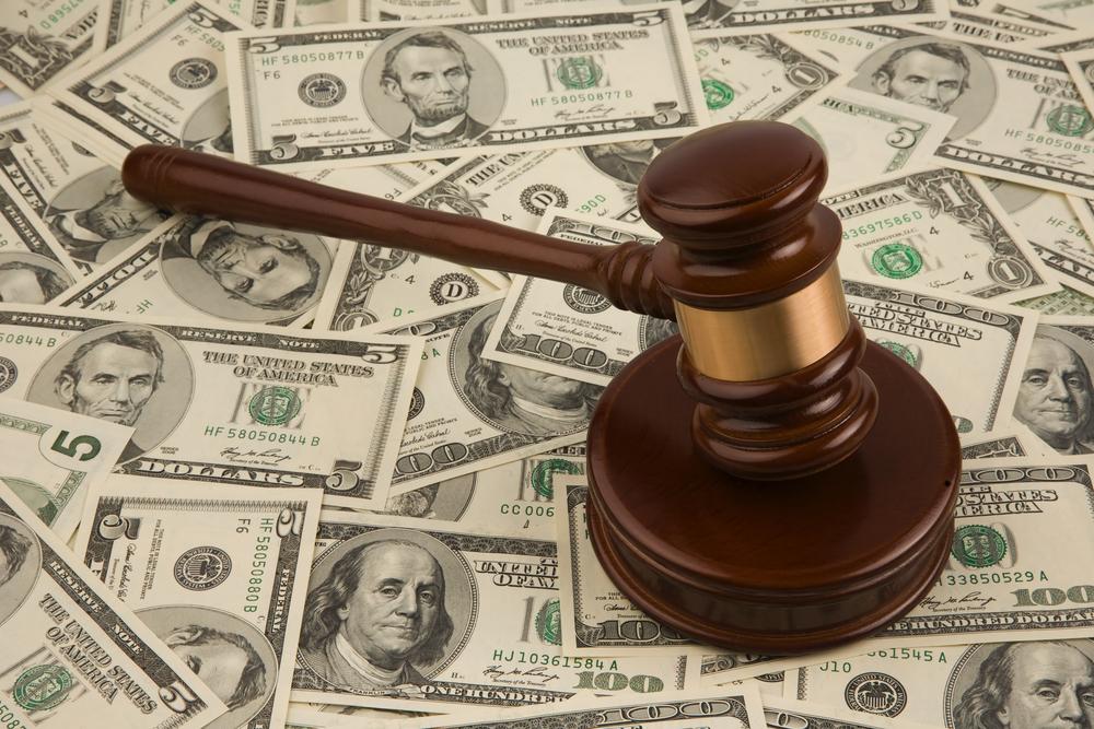 Judge gavel on pile of cash