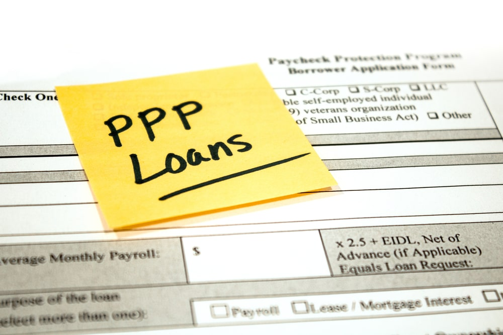 PPP loan application with sticky note