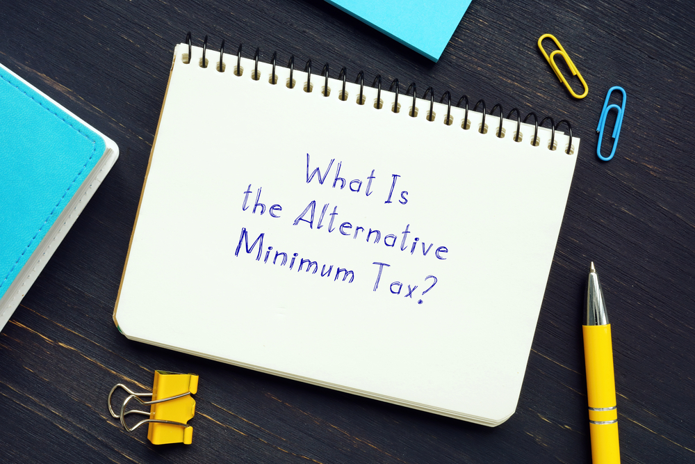 """Notepad with words """"What is the alternative minimum tax?"""""""