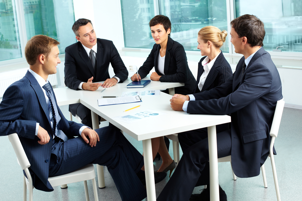 Business professionals around conference table