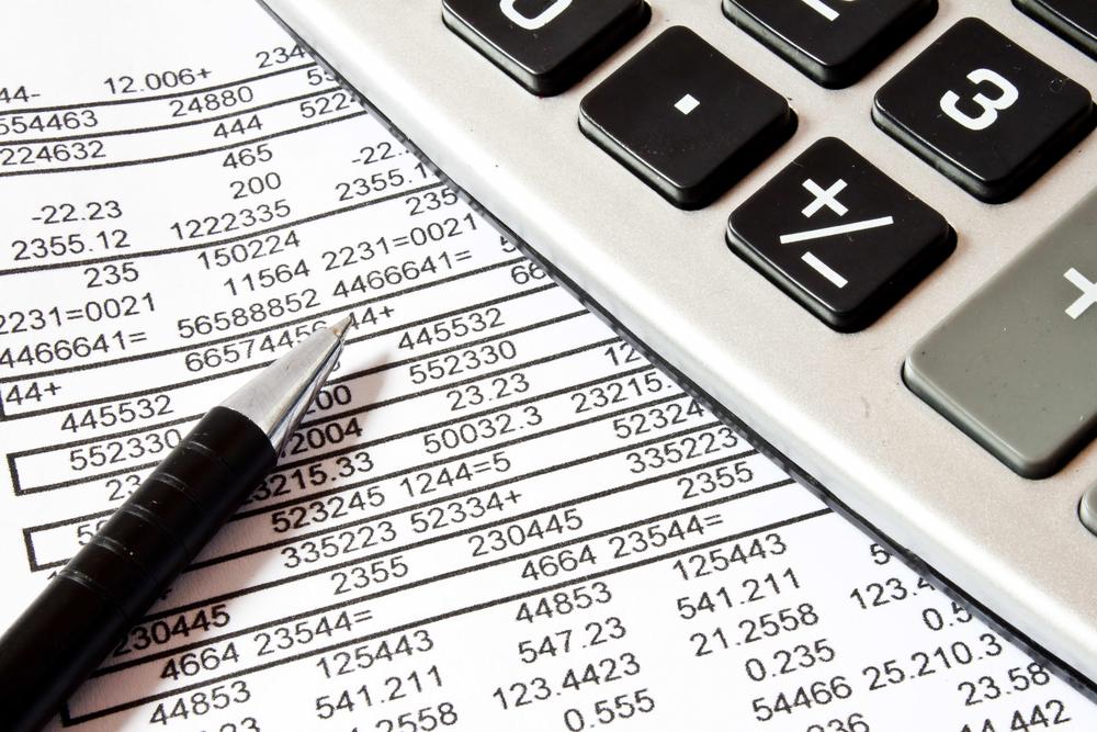 Calculator, pen, and spreadsheet