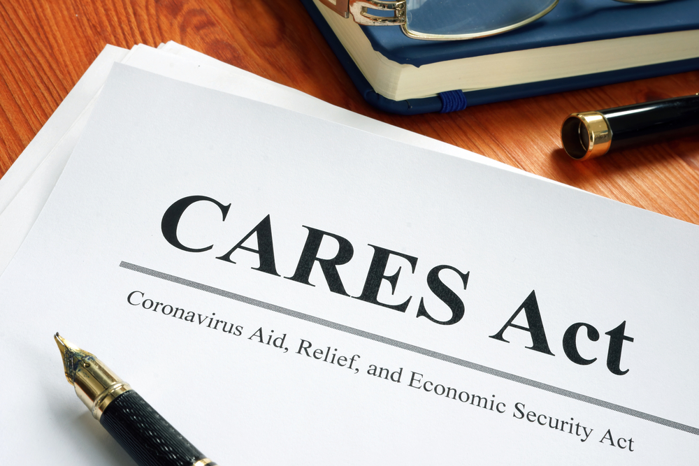 CARES Act document on desk with pen