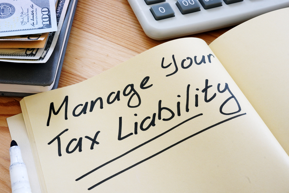 Manage your tax liability written in notebook