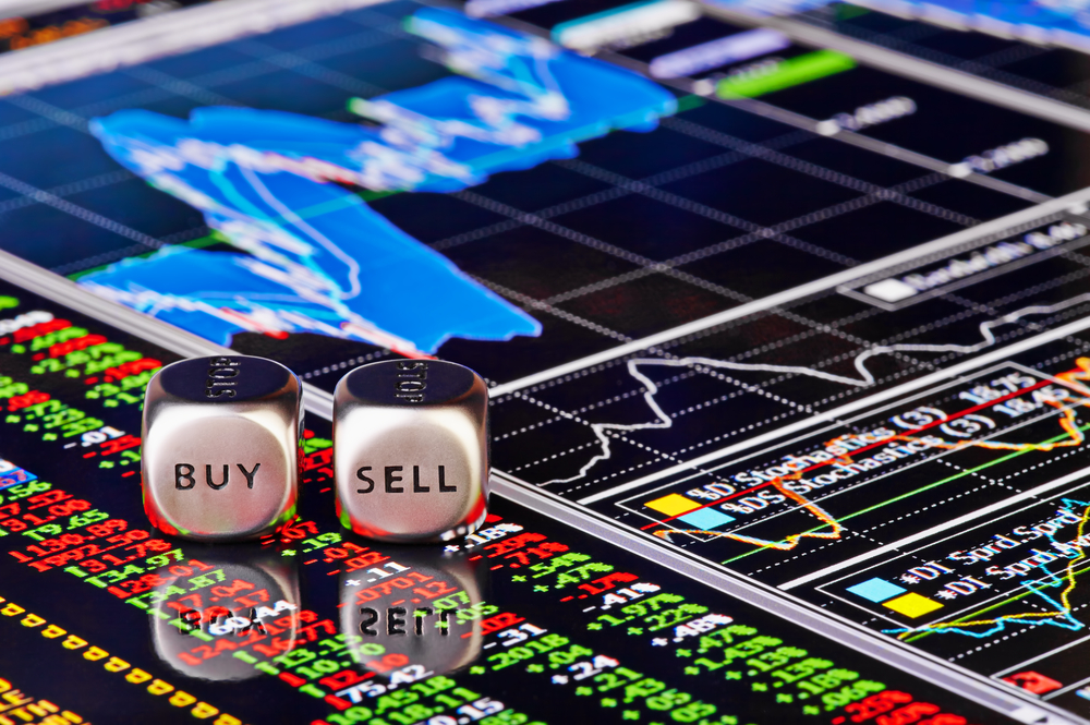 Stock trader board with Buy and Sell dice