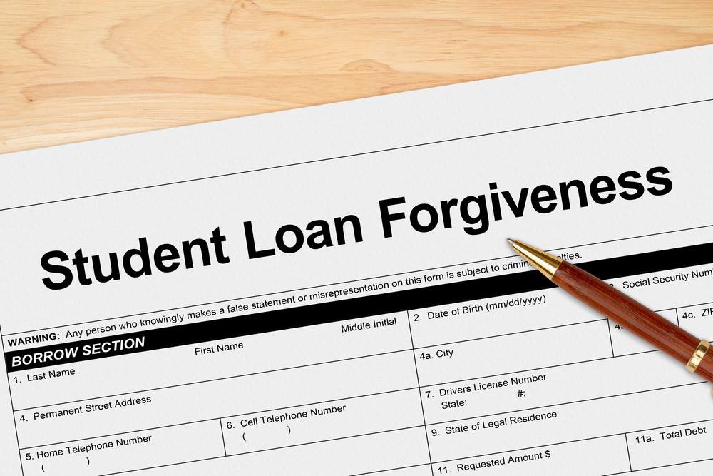 Student loan forgiveness application with pen
