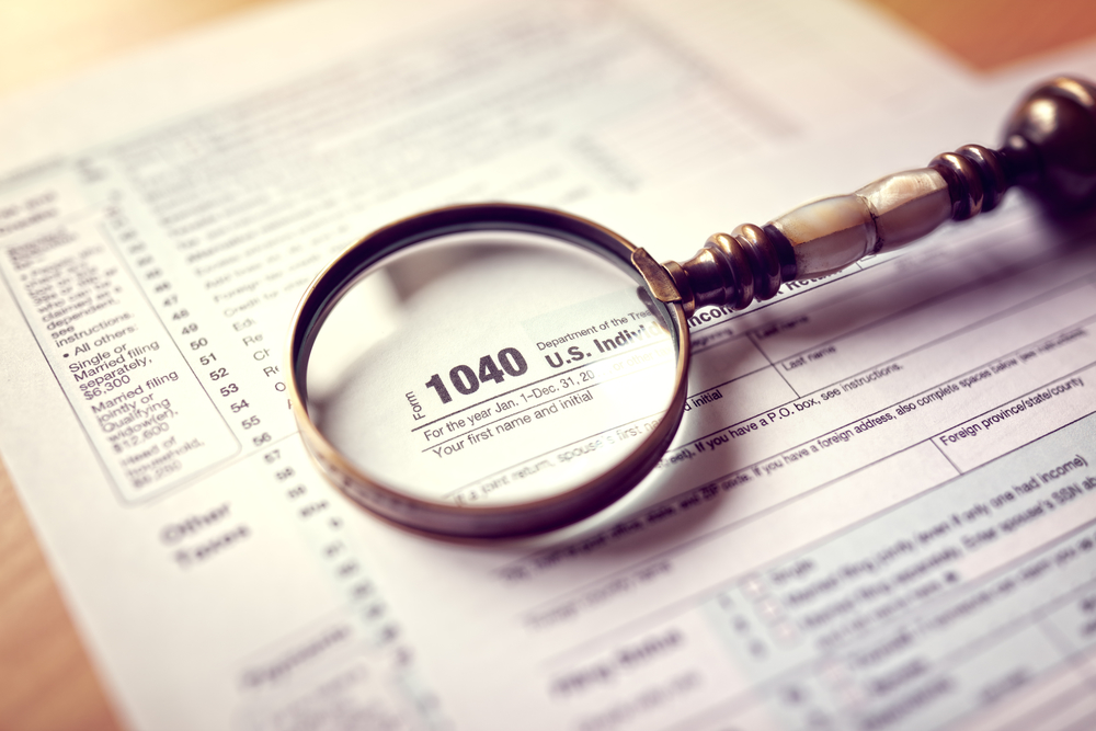 Magnifying glass over tax return