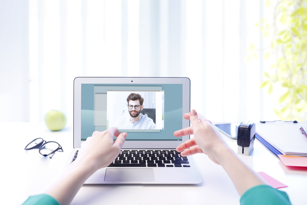 Woman video chatting man on computer